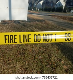 yellow tape that says fire line do not cross