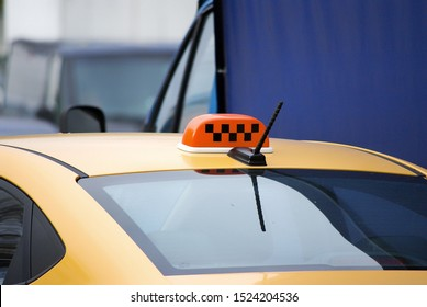 Yellow taxi car with a checkered