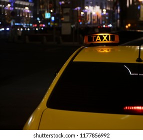 yellow Taxi car on the street at the night.