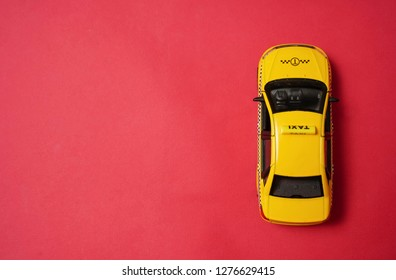 yellow taxi car - top view . Transport sign, auto, drive and symbol. red background. empty copy space for inscription.