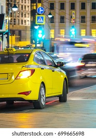 Yellow taxi in a center of Moscow
