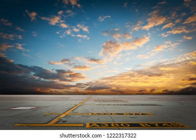 Yellow taxi line for airplane parking with nice sky