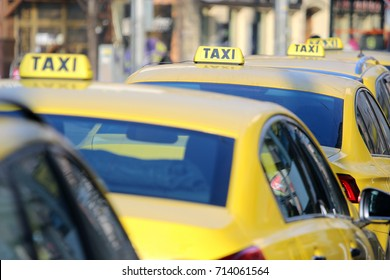 Yellow taxi in line on the street