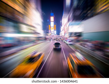 Yellow taxis on time square at night with motion blur