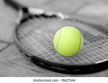 Yellow Tennis ball on a racket