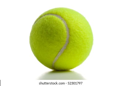 Yellow tennis ball over white with shadow below
