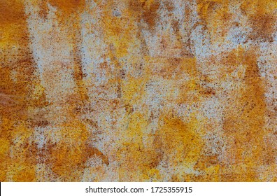 Yellow textured grained rusty grungy aged metal background.