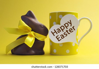 Yellow theme polka dot breakfast coffee mug with chocolate bunny rabbit and heart shape message saying Happy Easter.