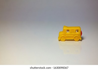 Yellow tiny toy van and ministers from the window.