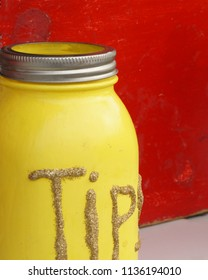 Yellow tip jar with glitter lettering