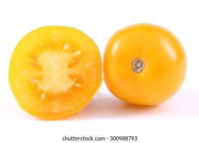 Yellow tomato and a half a tomato