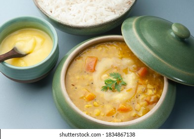 Yellow toor daal, rice with ghee butter topping. A comfort food popular in India and called daal chaval or daal bhaat