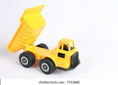 Yellow Toy Dump Truck over White