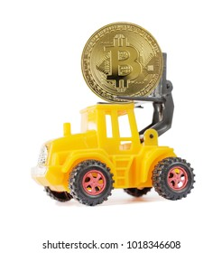 Yellow toy forklift transports a symbolic coin of bitcoin crypto currency, new digital money in cyber world, isolated on a white background, side view