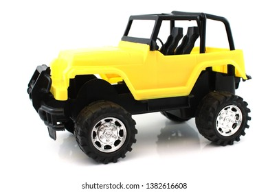 yellow toy jeep isolated on white background
