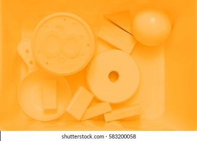 Yellow toys. Color background.