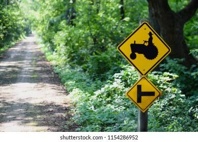 yellow tracktor crossing sign on post along bike path on Illinois wisconsin border
