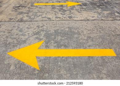 Yellow Traffic arrow on concrete road