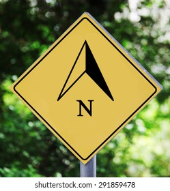 Yellow traffic label with north arrow pictogram