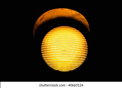 yellow traffic light, isolated on black background