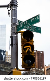 Yellow traffic light on the intersection of Central Park South and Colombus Circus
