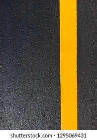 Yellow traffic paint on the road