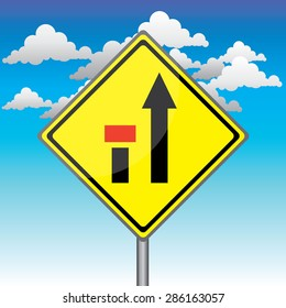 Yellow traffic square shaped Ending Left Lane sign with post on blue sky background