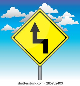 Yellow traffic square shaped Left Double Curve sign with post on blue sky background