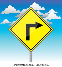 Yellow traffic square shaped Right Curve sign with post on blue sky background