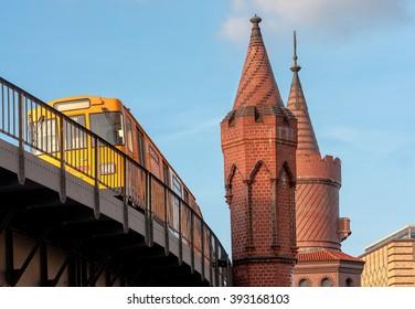 Yellow train on the Oberbaum bridge in Berlin, Germany