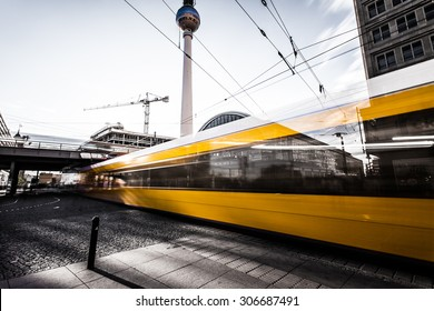 Yellow tram at Berlin Alexanderplatz. In the background you can see the TV tower and the station