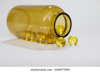 yellow transparent round tablets in a transparent bottle