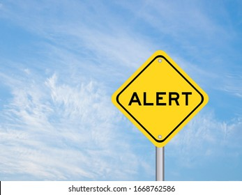 Yellow transportation sign with word alert on blue sky background