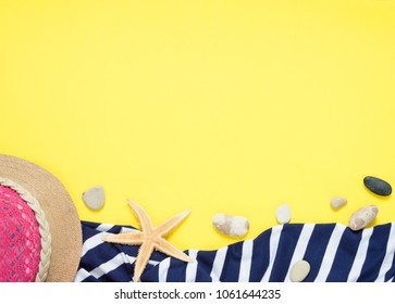 Yellow travel concept for see or beach. Hat, seastar, towel, sundress with stripes. Flat layout summer.  Traveller accessories.