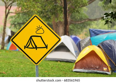 Yellow triangle warning sign, warning sign, lable, Yellow warning sign, Yellow sign Camping tent area, campground on the campground background