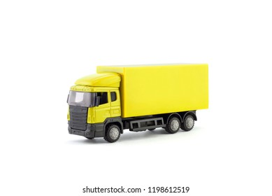 Yellow truck miniature on white background