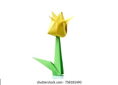 Yellow tulip origami flower. Traditional model of bulb and leaf. Simple origami crafting for beginners.