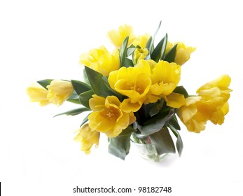 Yellow tulips bouquet on a white background. Shot with natural light.