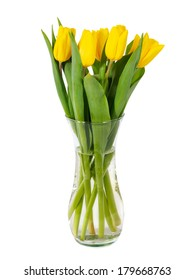 Yellow tulips in glass vase with water isolated on white background