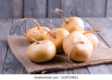 Yellow turnip on a wooden table. Lenten dishes.