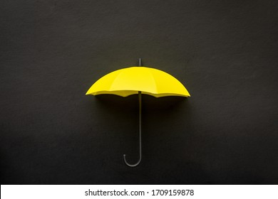 Yellow umbrella 3D icon isolated on black background