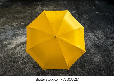 yellow umbrella on the ground with dramatic tone