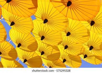 Yellow umbrella open against the sky. Protection shadow. Parasol