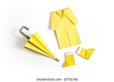 Yellow umbrella, raincoat and rainboots