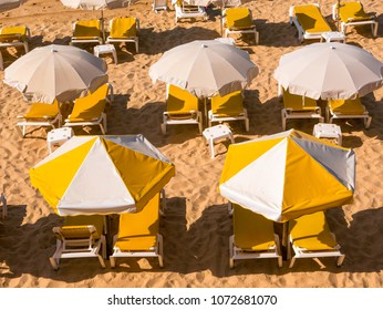 Yellow umbrellas on the beach