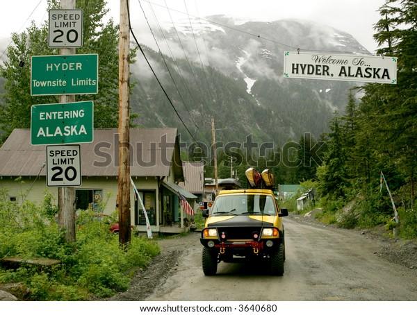 Yellow van on street of Hyder, Alaska