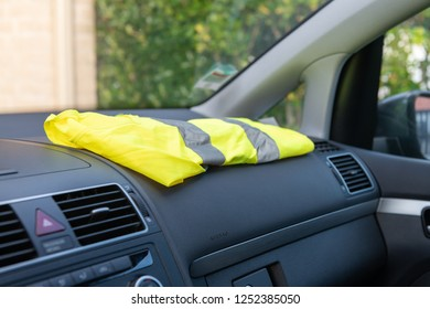 Yellow vest on a dashboard car in protest against tax increases in France