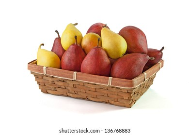 Yellow and vinous pears in the basket isolated on white background