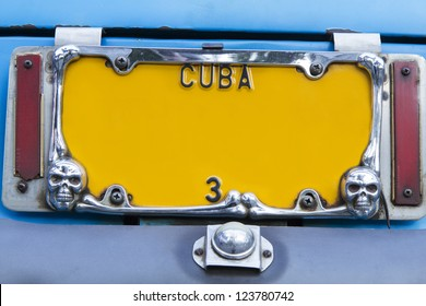 Yellow vintage numberplate on Cuba