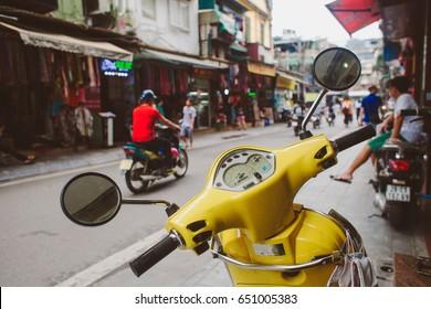 Yellow vintage style motorbike at Hanoi street, Vietnam